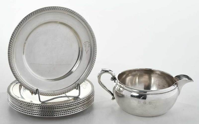 Eight Sterling Plates and Sterling Creamer