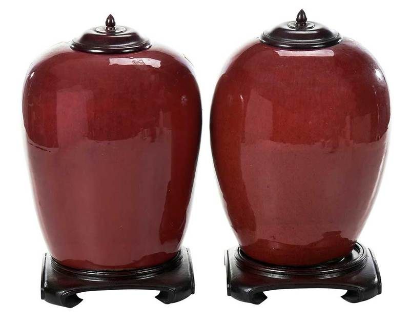 Near Pair Chinese Sang de Boeuf Jars on Stands