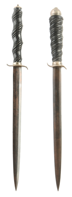 Two Similar Daggers with Carved Wood Grips