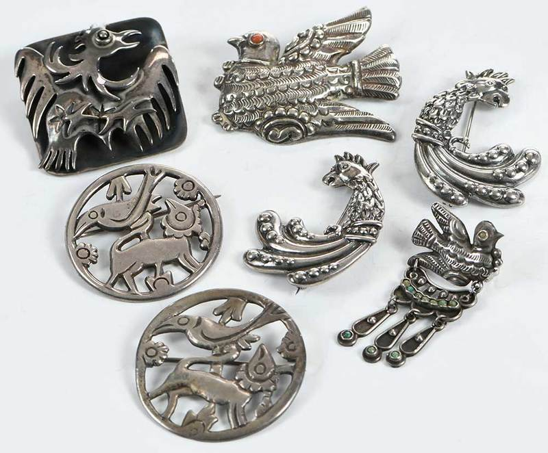 Seven Silver Brooches