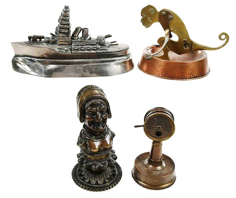 Four Figural Cigar Cutters and Lighters