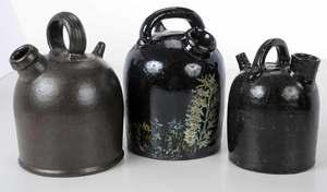 Three Stoneware Monkey Jugs