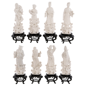 Eight Blanc de Chine Standing Figures on Stands
