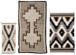 Two Navajo Rugs and a Saddle Blanket