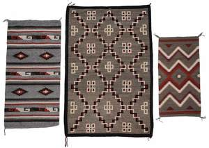 Two Navajo Transitional Rugs and a Saddle Blanket