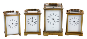 Four Brass and Beveled Glass Carriage Clocks