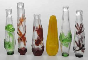 Six Carved Peking Glass Bottles