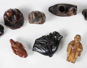 Eight Carved Wood Netsuke Figures