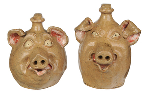 Two William Flowers Pig Jugs
