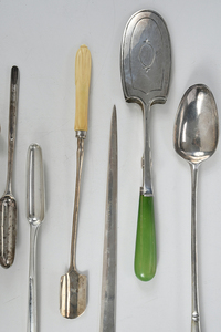 Eight English Silver Serving Utensils