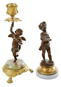 Two Patinated Bronze Figural Candlesticks