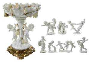 Eight Putti Figural Porcelain Pieces