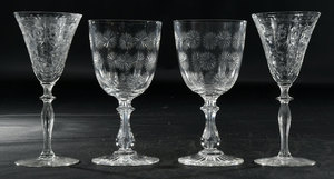 Nine Engraved and Cut Glass Stems
