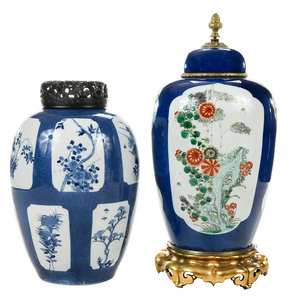 Two Chinese Powder Blue Vases with Floral Panels