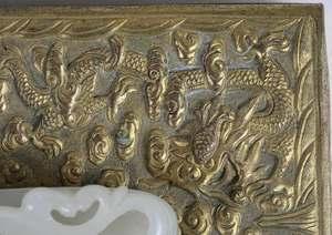 Two Chinese Jade Belt Hooks on Gilt Bronze Boxes