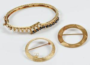 Two Brooches and Bracelet