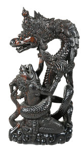 Carved Wood Mythical Figures in Battle