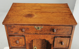 A George I Inlaid Burlwood Miniature Desk