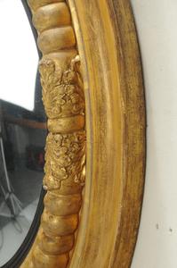 Irish Regency Gilt and Ebonized Convex Mirror