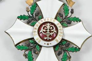 Four Russian Enamel Decorated Imperial Badges