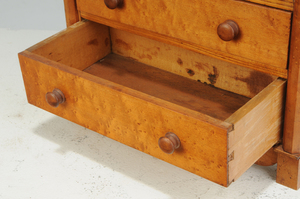 Three Diminutive Chests of Drawers