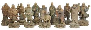 11 Carved Wood and Polychrome Buddhist Deities