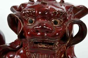 Pair Red Glazed Foo Dogs, with A Glass Sculpture