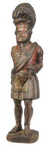 Carved and Polychrome Tobacconist Figure