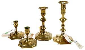 Four Early Georgian Brass Candlesticks