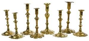 Eight Georgian Brass Candlesticks