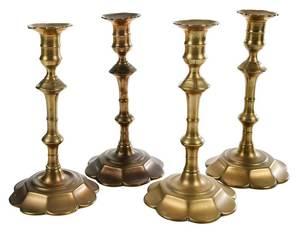 Four Georgian Brass or Bell Metal Candlesticks