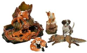 Four Fox Figurines