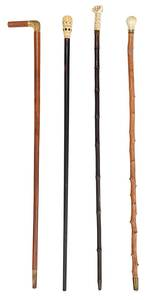 Four Walking Sticks with Bone and Ivory Tops