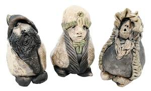 Three Small Pottery Figures with Hats
