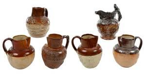 Six Stoneware Tavern Pitchers