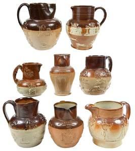 Eight Stoneware Tavern Pitchers