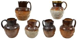 Six Sprig Decorated Stoneware Tavern Pitchers