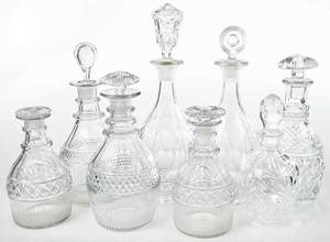 Eight Cut Glass Decanters with Stoppers