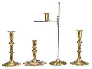 Group of Four Brass Candlesticks