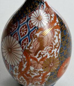 A Finely Decorated Japanese Imari Bottle Vase