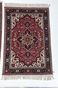 Two Similar Tabriz Rugs