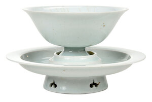 A Qingbai Porcelain Cup and Pierced Trefoil Stand