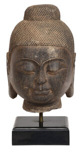 Carved Stone Buddha Head Mounted on Marble Base