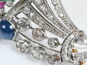 Pair of Platinum, Gemstone and Diamond Brooches