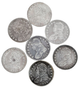 Seven Capped Bust Half Dollars
