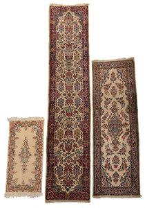 Three Kerman Rugs