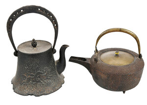 Two Japanese Iron and Brass Lidded Teapots