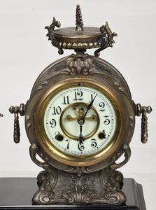 Gilt Bronze and Metal Figural Mantel Clock