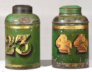 two green tole painted tea cannisters