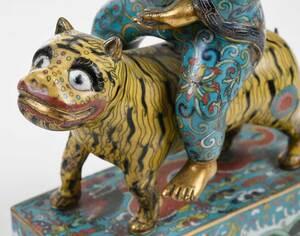 A Chinese Cloisonné Figure Riding a Tiger